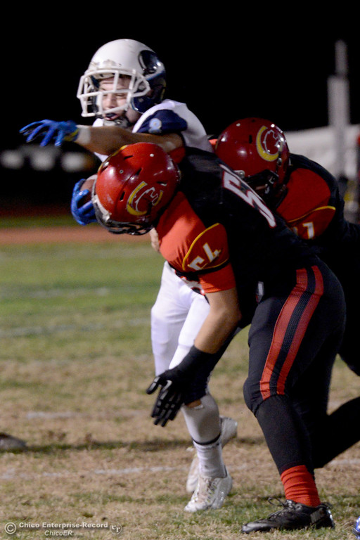 . Chico\'s Bailey Fritter (54) and Nick Whichello (51) tackle Pleasant Valley running back Ethan Nash (8) during the Almond Bowl at University Stadium in Chico, California. (Dan Reidel -- Enterprise-Record)