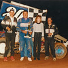 Johnny Ziehl (blue firesuit) and Jamie Dryden on far right.