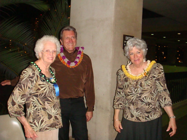 cuer Bill and wife Linda with their dancer Joyce had green lei