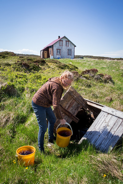 Fetching water from the well on a small island called Risøy along the Norwegian coast. The island has no tapwater or electricity.