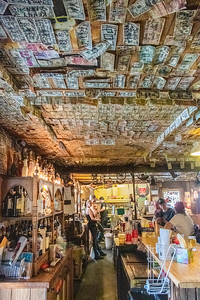 Decades of ceiling placement of bills!
