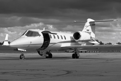 N633SF - Learjet 31A - With a Black & White Twist - On the Ramp at KLPR!  © 2010 Paul L. Csizmadia  All Rights Reserved  No Use Allowed without Permission