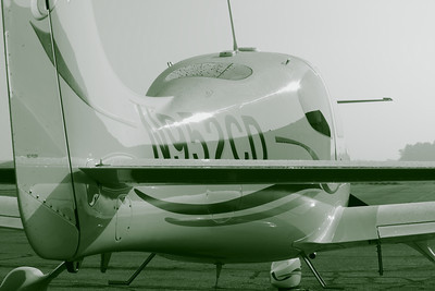 N952CD - A Tailplane Perspective!  © 2010 Paul L. Csizmadia  All Rights Reserved  No Use Allowed without Permission  With a touch of monochrome and covered with morning dew, N952CD a Cirrus SR20 sits on the ramp on hazy, humid summer morning at KLPR (Lorain County Regional Airport).
