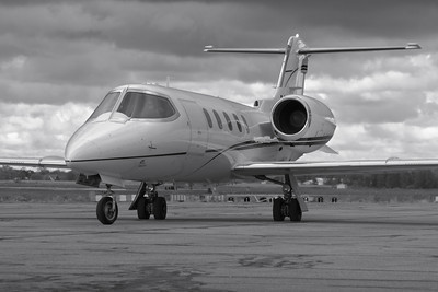 N633SF - A Learjet 31A Departs the Ramp at KLPR with a B&W Twist!  © 2010 Paul L. Csizmadia  All Rights Reserved  No Use Allowed without Permission
