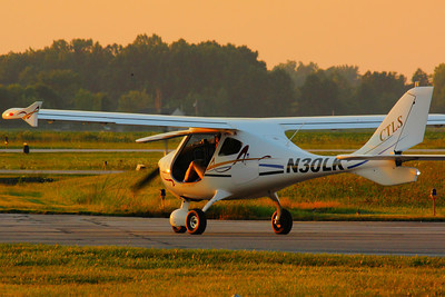 N30LK - Headed for a Sunset Flight at KLPR!  © 2010 Paul L. Csizmadia  All Rights Reserved  No Use Allowed without Permission  N30LK a Flight Design CTLS 'Light Sport Aircraft' heads out for a little sunset flying time over Lorain County from KLPR (Lorain County Regional Airport).