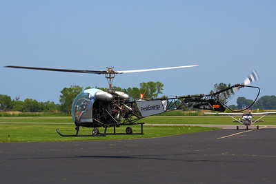 A Classic Whirlybird!  N6776D a Bell 47G-2 helicopter, manufactured in 1959 takes to the air from SKY (Griffing Sandusky Airport) after a refueling stop in Sandusky, Ohio.