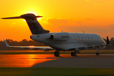 N300FS - Sunset at KLPR!  © 2010 Paul L. Csizmadia  All Rights Reserved  No Use Allowed without Permission  N300FS a Bombardier BD-100-1A10 Challenger 300 owned by Aliquant Corporation soaks up the sunset on the ramp at KLPR (Lorain County Regional Airport) in Lorain County, Ohio.