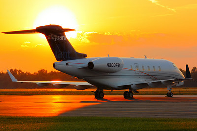 N300FS - 'Challenger 300' Sunset at KLPR!  © 2010 Paul L. Csizmadia  All Rights Reserved  No Use Allowed without Permission  N300FS a Bombardier BD-100-1A10 Challenger 300 owned by Aliquant Corporation soaks up the sunset on the ramp at KLPR (Lorain County Regional Airport) in Lorain County, Ohio.