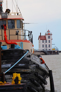 The Tug and a Light!  The end of a day finds the U.S. Army Corps of Engineers tug 'Cheraw' alongside the crane barge 'McCauley' with the Lorain West Breakwater Lighthouse in the background.