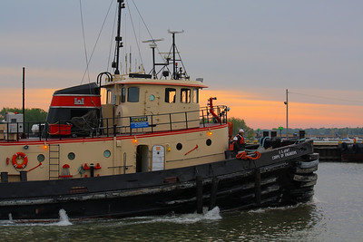 A Busy Tug!  U.S. Army Corps of Engineers large Harbor Tug 'Cheraw' prepares to come around and pick up a barge in the harbor waters surrounding Lorain, Ohio shortly after sunrise.