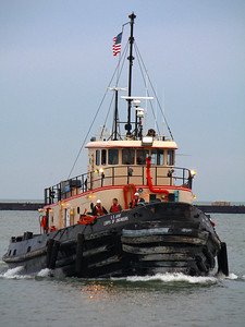 Tugging Around!  The crew of the tug 'Cheraw'  off to an early start in the harbor waters of Lorain, Ohio.