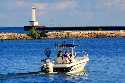 It's Fishin' Time On Lake Erie!  With a temperature of 68°F (20°C) and the wind at 8 - 10 knots out of the NE with scattered clouds.  The day is off to a great start for fishing along the shores of Lake Erie in Lorain, Ohio.