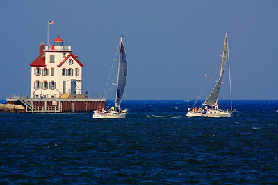 """Heading Out - 80th Annual Lorain Sailing & Yacht Club Regatta  Passing the """"West Breakwater Lighthouse"""" and heading out onto Lake Erie for the 80th Annual Lorain Sailing & Yacht Club Regatta in Lorain, Ohio."""