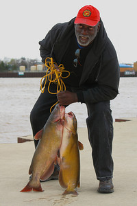 Samuel L. Felton Jr. - Catfish Catch - At the Mouth of the Black River - Lorain, Ohio  © 2011 Paul L. Csizmadia  All Rights Reserved  No Use Allowed without Permission  Lorain County 'Veteran of the Year 2010' - Sam Felton Jr. displays his catch of 'Catfish' at the mouth of the Black River in Lorain, Ohio.  A veteran of the 'Vietnam War', Sam was awarded the 'Navy Cross' for his heroism and valor.    Good news for the Catfish - Sam tossed the sizeable pair back into the river to get caught another day.