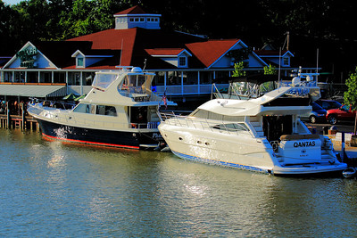When you get the Munchies while Cruising!  Where else but a restaurant with dockage,  'Quaker Steak & Lube' on the Vermilion River in Vermilion, Ohio.  The 54.2 ft. motor yacht 'Phantom' on the left and the 58 ft 'Qantas' on the right both out of Buffalo, NY take advantage of the dockside dining.