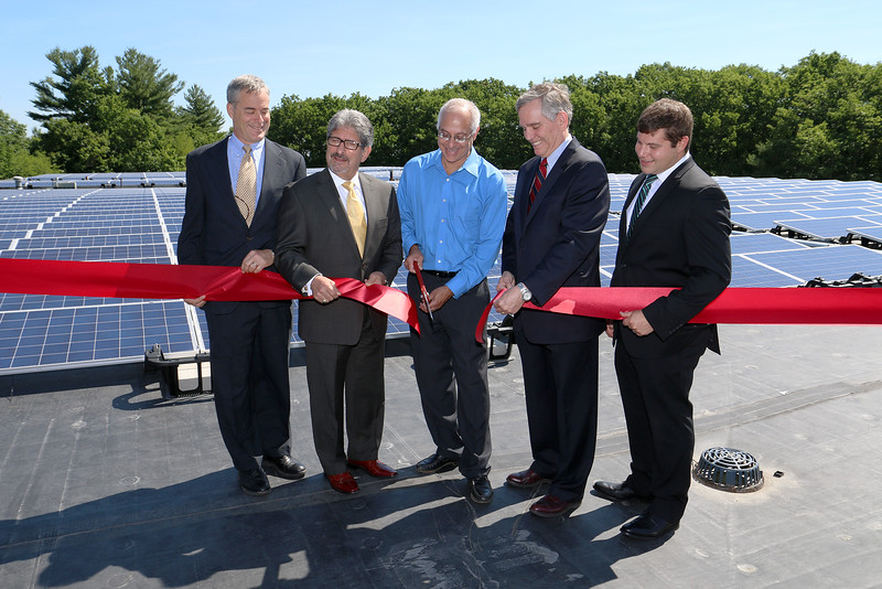 Alpha Rho in Fitchburg has put in solar panels that will produce more than 80 percent of the power needed to run the company's manufacturing warehousing and administrative operations. The panels where put in, on the company's roof, by New England Clean Energy out of Hudson. Cutting the ribbon is President of Alpho Rho David Tall, in blue shirt. With him from left is CEO of N.E. Clean Energy Jim Elkind, Fitchburg Mayor Stephen DiNatale, David, Sales Director for N.E. Clean Energy Doug McCartney and Vice President of Installation from N.E. Clean Energy Jonathan Williams. SENTINEL & ENTERPRISE/JOHN LOVE