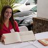 Alpha House Volunteer Bridget Murtha helps create guest book memories