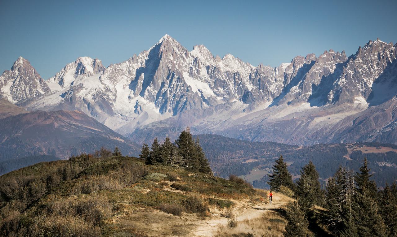 Mountain biking on the Tête du Torraz with the Aiguille Verte behind, Chamonix, France