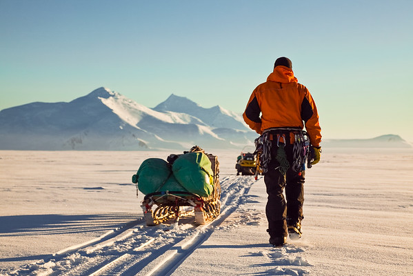 Marty Benevente checking sledges on a Skidoo traverse, Adelaide Island, Antarctica