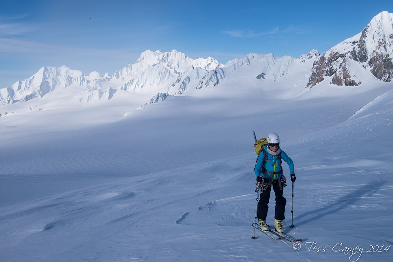 Ann skinning her way up to West Hoe Pass with the Davis Snowfield in the background.
