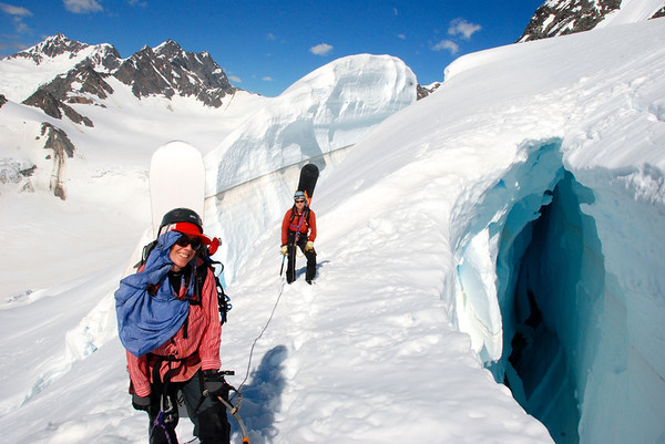 Snowboard Mountaineers Tess Carney and Ben Pritchard,  first descent of Mt Atkin,  Murchison Glacier, New Zealand 2010.  Photo by Shane Orchard