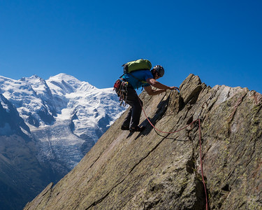 "Climber on the ""Razor's Edge"" pitch on the Aiguille de la Gliere. Mont Blanc in the background. Chamonix, France."