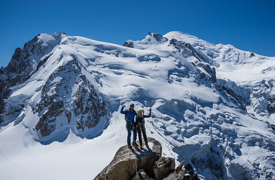 Climbers on the Cosmiques Arete. Mont Blanc du Tacul, Mont Maudit & Mont Blanc in the background. Chamonix, France.