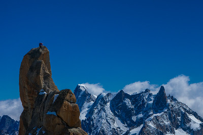 Climber topping out on the South Face of the Aiguille du Midi. Chamonix, France.