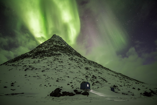 Aurora Borealis over a hunter's cabin, East Greenland