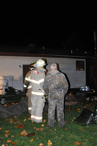 Chief Ron discussing what is going on with the owner of the house.