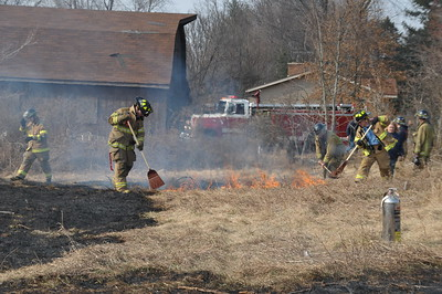 ATFD and Walker Fire work together to put out the remaining flames...