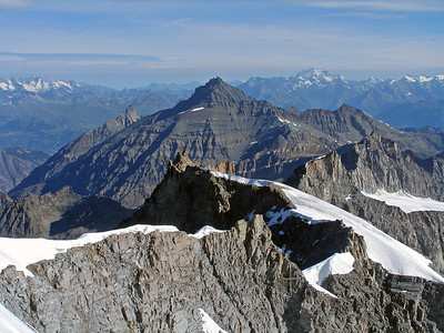 La Grivola ('the Maiden' in Occitan, or Langue d'oc), 3969m, lies 8 or 9km almost due north of the Paradiso. The great bulk of the Grand Combin is to the right, with Mont Dolent and its neighbours to the left. In the foreground is the complex ridge running from the Herbetet.  9.25am, 28/07/10