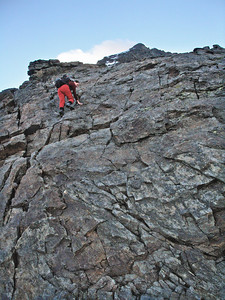 On the Lagginhorn WSW ridge.  This gives a wholly misleading impression of the WSW ridge (PD). This slab, maybe 15m high, is riven by cracks and ledges and is a fairly simple scramble, though some parties do rope up for it. The rest of the ridge is a rather dull affair of boulder and rubble, the upper parts covered, if you are lucky, by snow.  7.15am, 21/07/10