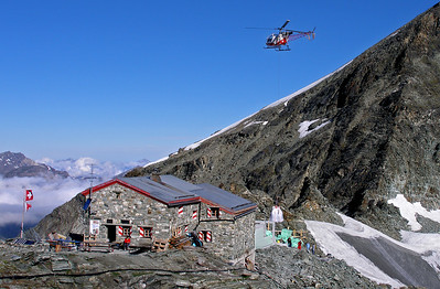 Cabane Tracuit (CAS), 3256m.  8.00am, 30/07/12  The chopper is delivering materials for . . .