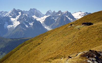 Cabane du Col de Mille (Commune de Liddes), 2473m,  Val d'Entremont.  Aiguille du Tour is the dominant peak, I think, with le Portalet to the left.  2pm, 19/09/98