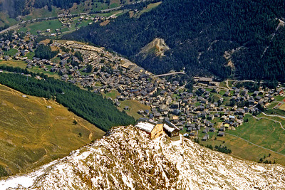 Mischabelhütten (AACZ), 3329m, with Saas Fee a vertical mile below them.  1pm, 02/09/03