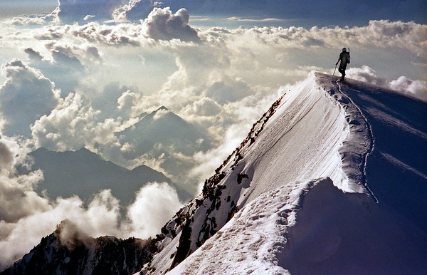 Weissmies summit ridge, with thunderclouds over Italy.<br /> <br /> 8am, 12/8/00