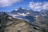 Strahlhorn from the Joderhorn.<br><br>2.30pm, 19/08/03<br><br>  ~ This view might surprise someone who has only seen the Strahlhorn from the opposite (Zermatt) side, where it appears as a pure snow peak. The SE face of the Allalinhorn (equally Jekyll-and-Hyde) is on the right.