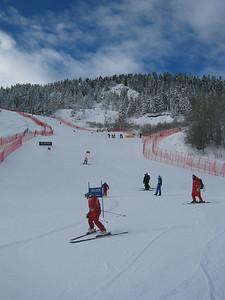 Athletes during super G course inspection (Dec. 9) Seven of nine pictures of the course.