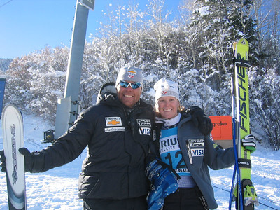 Women's Head Coach Patrik Riml and Kirsten Clark in the finish at the Sirius Aspen Winternational super G (Dec. 9)