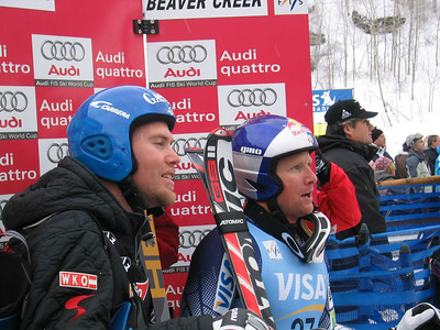 Austria's Hans Grugge and Daron Rahlves watch as Bode Miller comes down the downhill course at Visa Birds of Prey (Dec. 3)