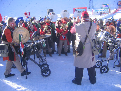 A band performs on the snow prior to the start of the women's downhill (credit: USSA)