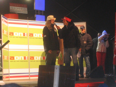 Lindsey Kildow chats with the emcee during the public bib draw in Altenmarkt Friday night (credit: USSA)