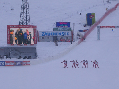 Cheerleaders perform in the finish area prior to Friday's anticipated downhill start (credit: USSA)