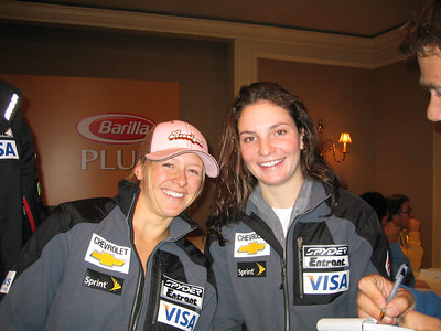 Two-time GS NorAm champions Jessica Kelley (Starksboro, VT) and current NorAm champ Megan McJames (Park City, UT) smile for the cameras the day before the Sirius Satellite Radio Aspen Winternational races (Nov. 24, 2006)