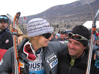 Pleased with her best finish at an opening race, 7th place, Julia Mancuso (Olympic Valley, CA) shares a hug and a smile with her Rossignol technician (Nov. 25)