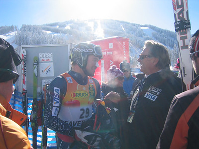 After winning the downhill portion of the super combined event, Bode Miller (Bretton Woods, NH) explains his run to Dr. Bill Steadman who assisted Miller with his knee in 2001. (Nov. 30)