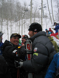 Men's Head Coach Phil McNichol and Bode Miller (Bretton Woods, NH) await the awards cermony at the Visa Birds of Prey downhill (Dec. 1)