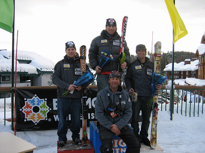 2007 NorAm Cup Super G Champions!  (l to r) Andrew Weighbrecht (2nd in rankings), Erik Fisher (1st), Travis Ganong (3rd) with Chief of Race for the Big Mountain Super Series/NorAm Cup Jeff Pickering in the lower center. The NorAm champions and second place finisher in the rankings win personal start rights to the World Cup SG for the 2008 season. Credit: U.S. Ski Team/Walt Evans