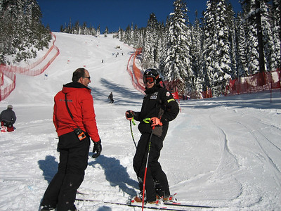 Travis Ganong (Tahoe, CA) and Development Team Head Coach Tom Sell during inspection for the final Super Series/NorAm Cup Super G at Big Mountain, MT (Feb 16, 2007). Credit: U.S. Ski Team/Walt Evans